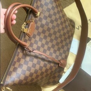 Authentic Loui Vuitton bag,used once.. $ 1,800